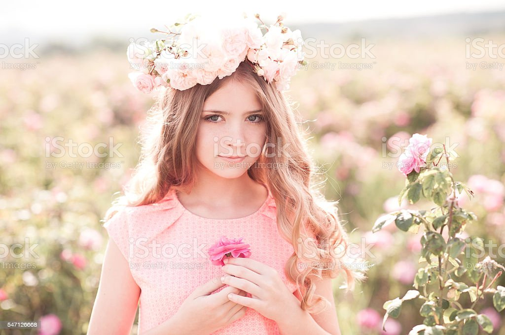 Closeup portrait of girl with flowers stock photo
