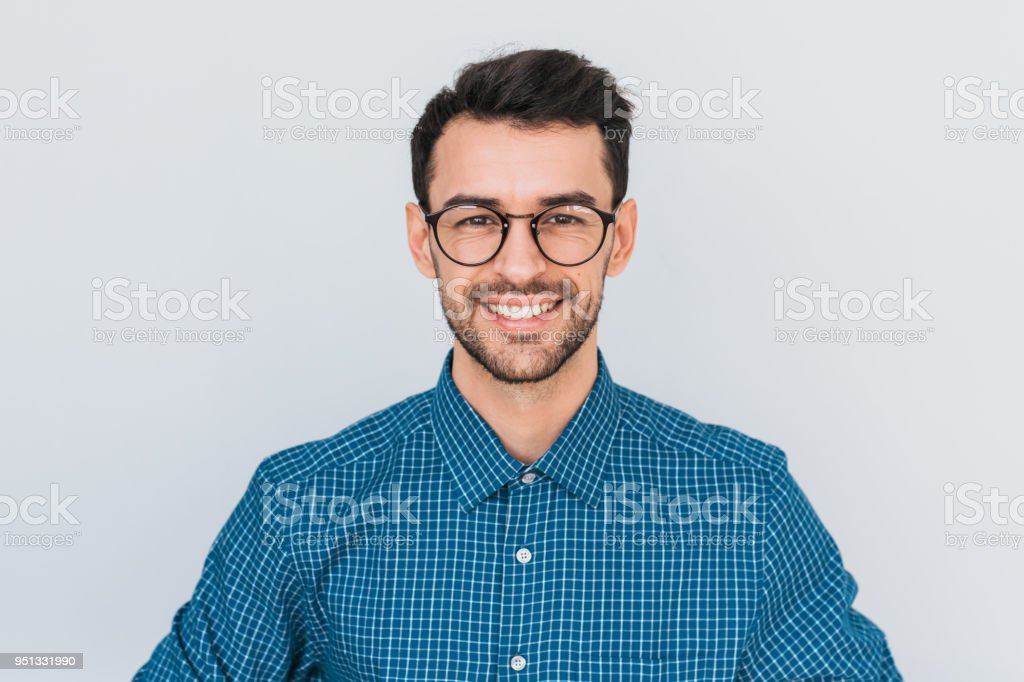 Closeup portrait of handsome smart-looking smiling with toothy smile male posing for social advertisement, isolated on white background with copy space for your promotional information or content. - fotografia de stock