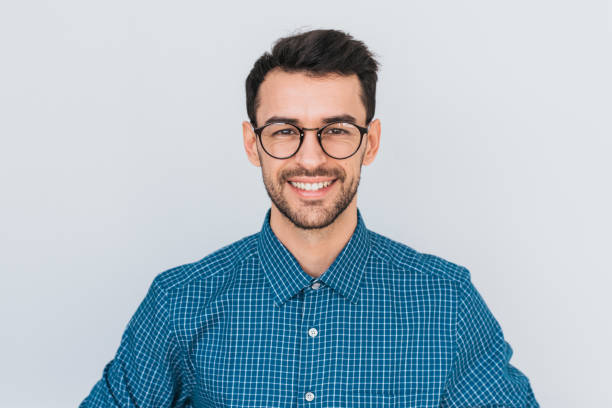 closeup portrait of handsome smart-looking smiling with toothy smile male posing for social advertisement, isolated on white background with copy space for your promotional information or content. - ritratto uomo foto e immagini stock