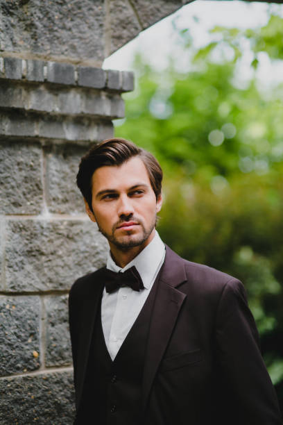 Close-up portrait of handsome young bridegroom with elegant stylish haircut stock photo