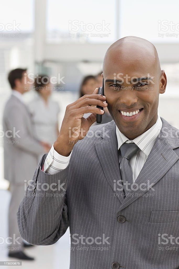 Closeup portrait of happy businessman talking on phone royalty-free stock photo