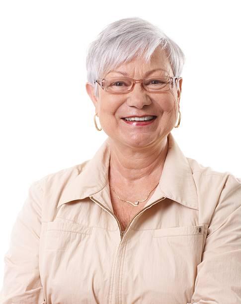 Closeup portrait of happy elderly lady stock photo