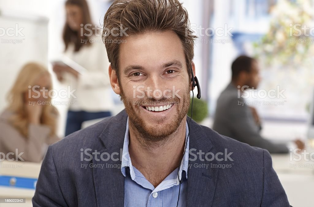 Closeup portrait of happy male dispatcher royalty-free stock photo