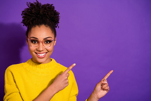 Close-up portrait of her she nice attractive cheerful cheery content wavy-haired, girl showing way direction copy space ad advert isolated over bright vivid shine violet background
