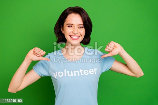 Close-up portrait of her she nice attractive cheerful girl wearing blue t-shirt recommending, herself organization community ecosystem save isolated over bright vivid shine vibrant green background