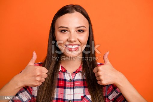 Close-up portrait of her she nice attractive lovely cheerful cheery content straight-haired girl showing double thumbup isolated on bright vivid, shine vibrant orange color background