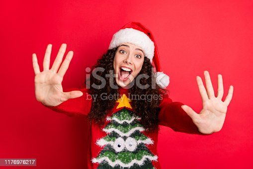 Close-up portrait of her she nice attractive lovely cute cheerful cheery wavy-haired Santa girl giving high five excellent advice isolated on bright vivid shine vibrant red color background