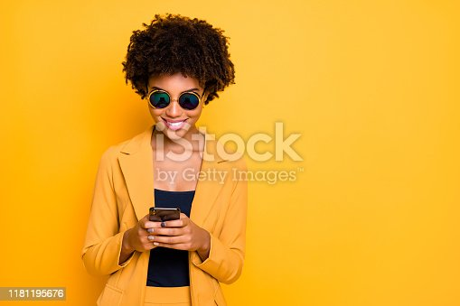 Close-up portrait of her she nice attractive lovely focused cheerful cheery, addicted wavy-haired girl using cell browsing web 5g app isolated on bright vivid shine vibrant yellow color background