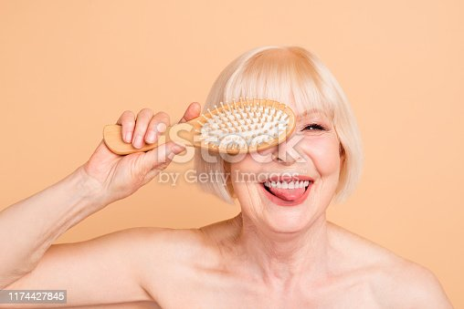 Close-up portrait of her she nice attractive nude naked well-groomed, cheerful cheery positive crazy foolish gray-haired lady having fun isolated over beige background