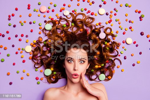 Close-up portrait of her she nice charming cute attractive lovely lovable, nude naked feminine wavy-haired lady candy addict shop isolated over violet purple pastel background