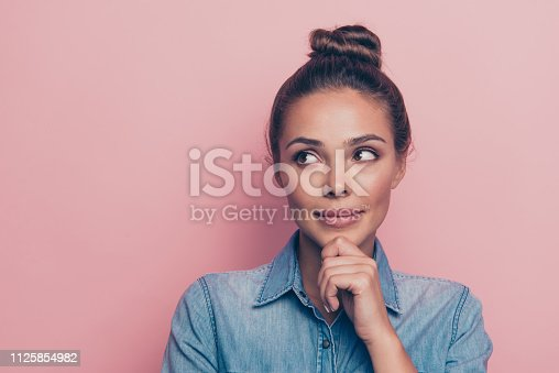 Close-up portrait of her she nice cute attractive winsome charming fascinating minded lady wearing blue shirt touching chin isolated over pink pastel background