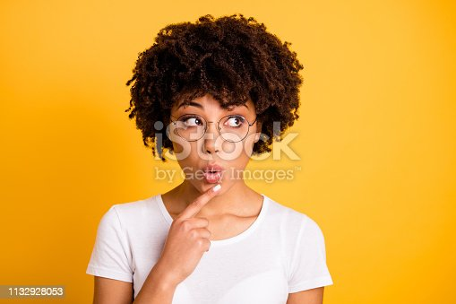 Close-up portrait of her she nice cute lovely charming attractive beautiful minded wavy-haired lady touching chin looking aside isolated over bright vivid shine background.
