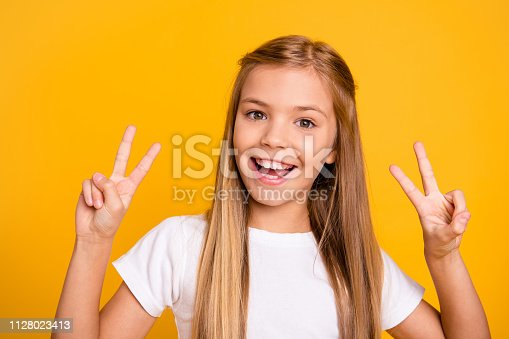 istock Close-up portrait of her she nice cute sweet adorable attractive lovely pretty cheerful cheery positive straight-haired girl showing double v-sign isolated over bright vivid shine yellow background 1128023413