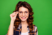 istock Close-up portrait of her she nice lovely winsome attractive cheerful cheery sweet wavy-haired girl wearing checked shirt glasses isolated on bright vivid shine green background 1156929042