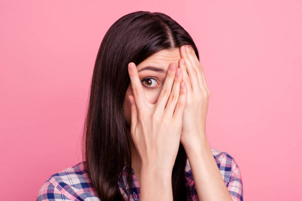 close-up portrait of her she nice-looking attractive charming lovely confused worried puzzled straight-haired lady closing face palms isolated over pink pastel background - donna si nasconde foto e immagini stock