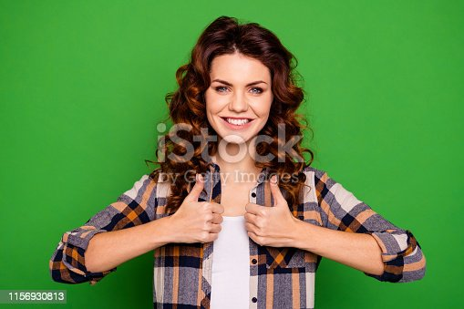 Close-up portrait of her she nice-looking attractive cheerful wavy-haired girl wearing checked shirt showing thumbup ad advertising advert isolated over, bright vivid shine green background