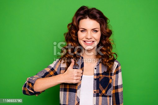 Close-up portrait of her she nice-looking attractive lovely cheerful wavy-haired girl wearing checked shirt showing thumbup isolated over bright vivid, shine green background
