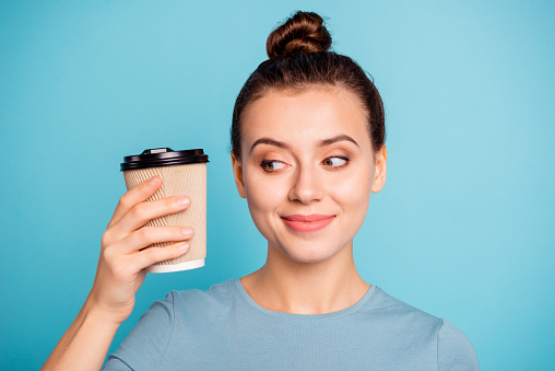 Close-up portrait of her she nice-looking attractive lovely winsome cheerful foxy content girl holding in hands hot sweet coffee take-away isolated over bright vivid shine turquoise background