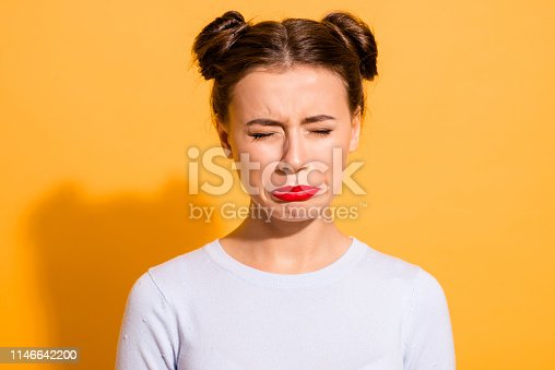 Close-up portrait of her she nice-looking attractive lovely winsome offended teen girl closed eyes grief dislike disgust isolated over bright vivid shine yellow background.