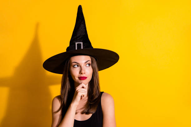 Close-up portrait of her she nice-looking attractive pretty glamorous minded lady wizard deciding clue copy space touching chin isolated on bright vivid shine vibrant yellow color background stock photo
