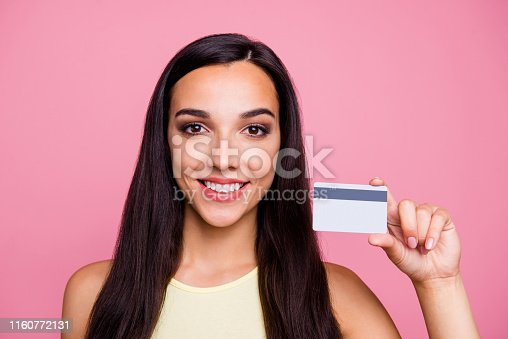 Close-up portrait of her she nice-looking lovely lovable attractive shine glamorous, cheerful cheery girl holding in hand new unlim card isolated over pink pastel background