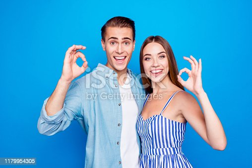 Close-up portrait of his he her she two nice attractive content cheerful cheery, excited glad people embracing showing ok-sign isolated over bright vivid shine vibrant blue color background