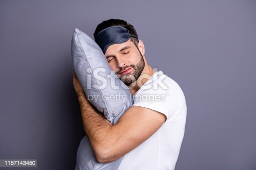 Close-up portrait of his he nice attractive bearded guy holding in hands pillow drowsiness, going to bed sleeping quietly calmly isolated over gray pastel violet purple background