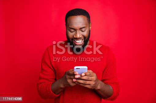 Close-up portrait of his he nice attractive cheerful cheery glad bearded guy, chatting 5g app wireless connection playing game isolated over bright vivid shine red background