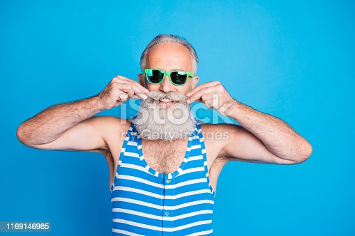 Close-up portrait of his he nice attractive content cheerful cheery gray-haired man touching mustache life lifestyle funky mood isolated over bright vivid shine turquoise blue background