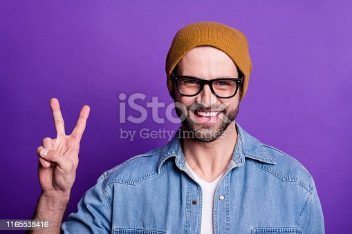 1165538246 istock photo Close-up portrait of his he nice attractive content cool cheerful cheery optimistic bearded guy showing v-sign isolated over bright vivid shine violet lilac background 1165538416