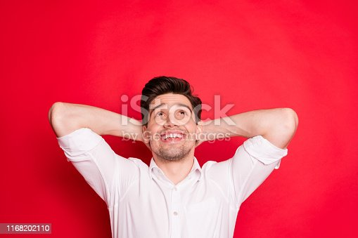 1165538246 istock photo Close-up portrait of his he nice attractive lovely cheerful cheery glad content guy enjoying free time looking up isolated over bright vivid shine red background 1168202110