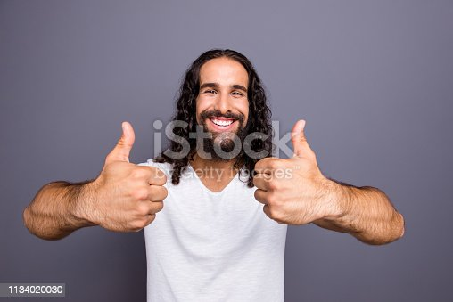 1092211952 istock photo Close-up portrait of his he nice trendy well-groomed attractive cheerful optimistic glad wavy-haired guy showing two thumbup ad advert isolated over gray violet purple pastel background 1134020030