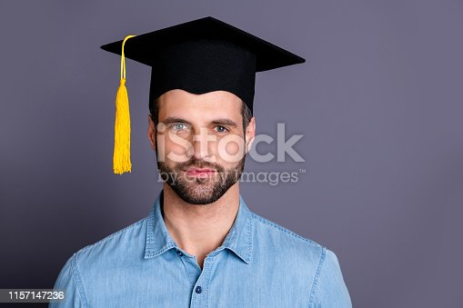 941829872 istock photo Close-up portrait of his he nice-looking attractive content successful bearded guy intellectual top manager isolated over gray violet purple pastel background 1157147236