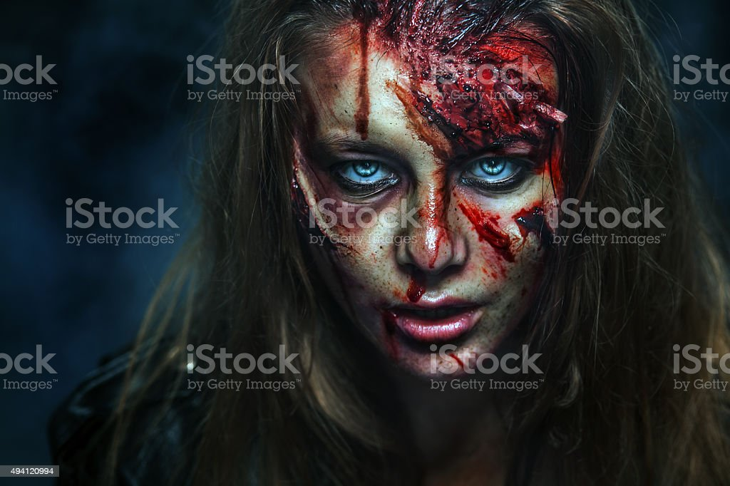 Close-up portrait of horrible zombie woman. Horror. Halloween stock photo