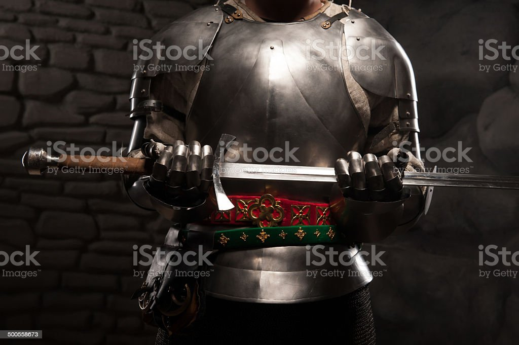 Closeup portrait of medieval knight in armor holding a sword stock photo
