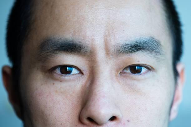 Closeup portrait of mid adult man stock photo