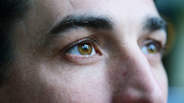 closeup portrait of mid adult man - eye stock pictures, royalty-free photos & images
