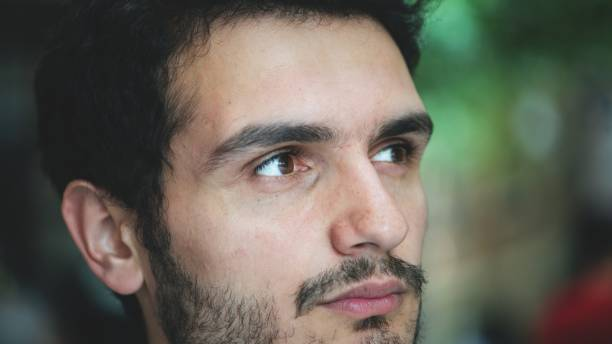 Closeup portrait of millennial man stock photo