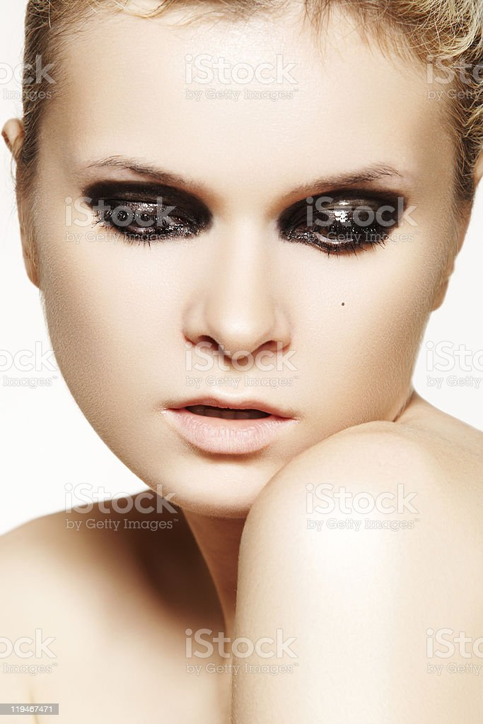 Close-up portrait of model with dark gloss make-up stock photo