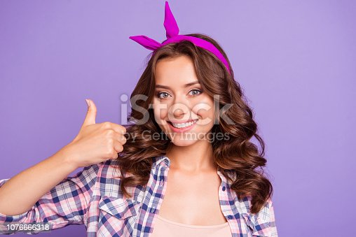 Close-up portrait of nice cheerful cheery girlish sweet lovely attractive lady wearing head band showing giving thumb-up isolated over violet pastel background
