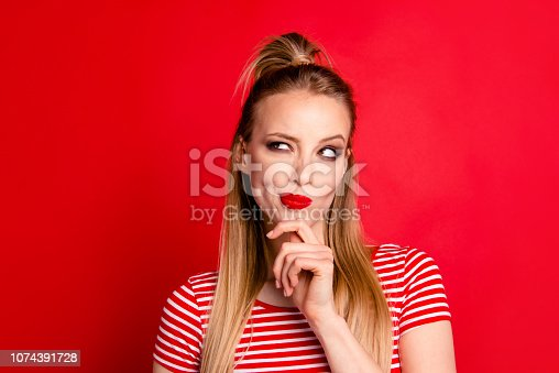Close-up portrait of nice shine cute funny adorable charming attractive girl wearing striped top touching chin looking aside isolated over bright vivid red background
