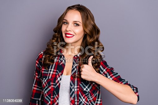 Close-up portrait of nice-looking cute attractive charming pretty winsome adorable cheerful wavy-haired lady cool shine look showing thumbup isolated over gray pastel violet background