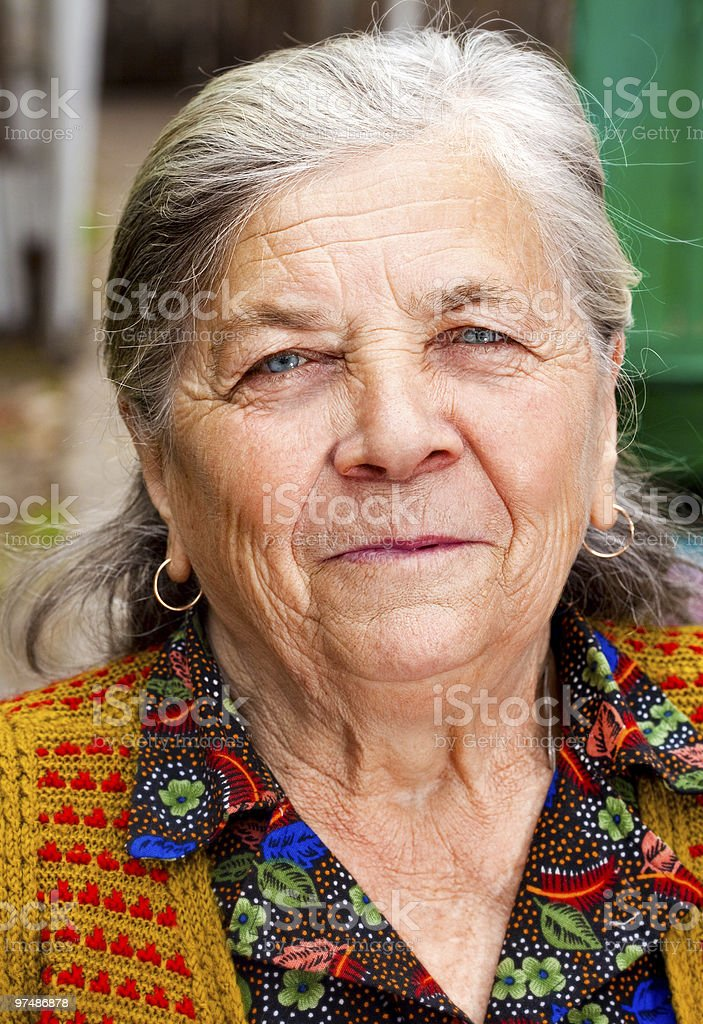 Closeup portrait of one content senior woman royalty-free stock photo