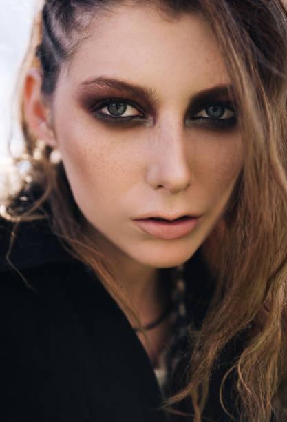 Close-up portrait of pretty grunge (rock) girl stock photo