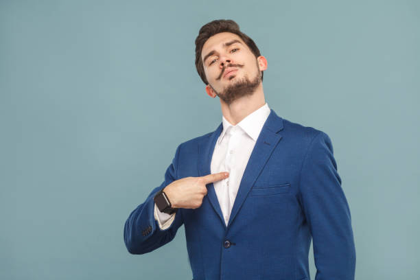 Closeup portrait of proud man pointing finger himself stock photo
