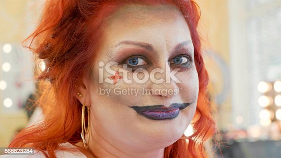 istock Close-up portrait of redhead woman with halloween makeup at beauty salon 868823284