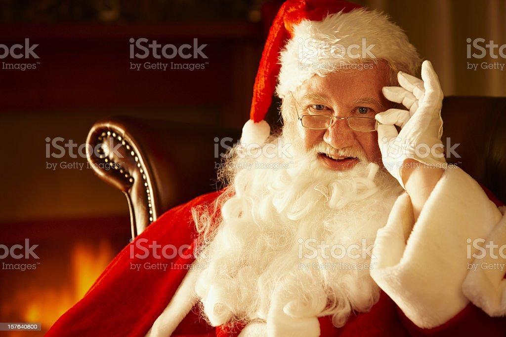 closeup portrait of Santa ajusting his glasses royalty-free stock photo