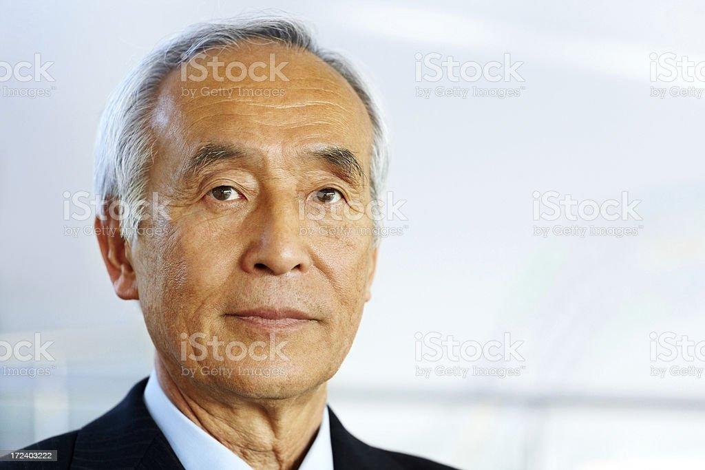 Closeup portrait of senior Japanese  businessman royalty-free stock photo