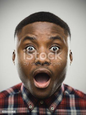 istock Close-up portrait of shocked man 639465968