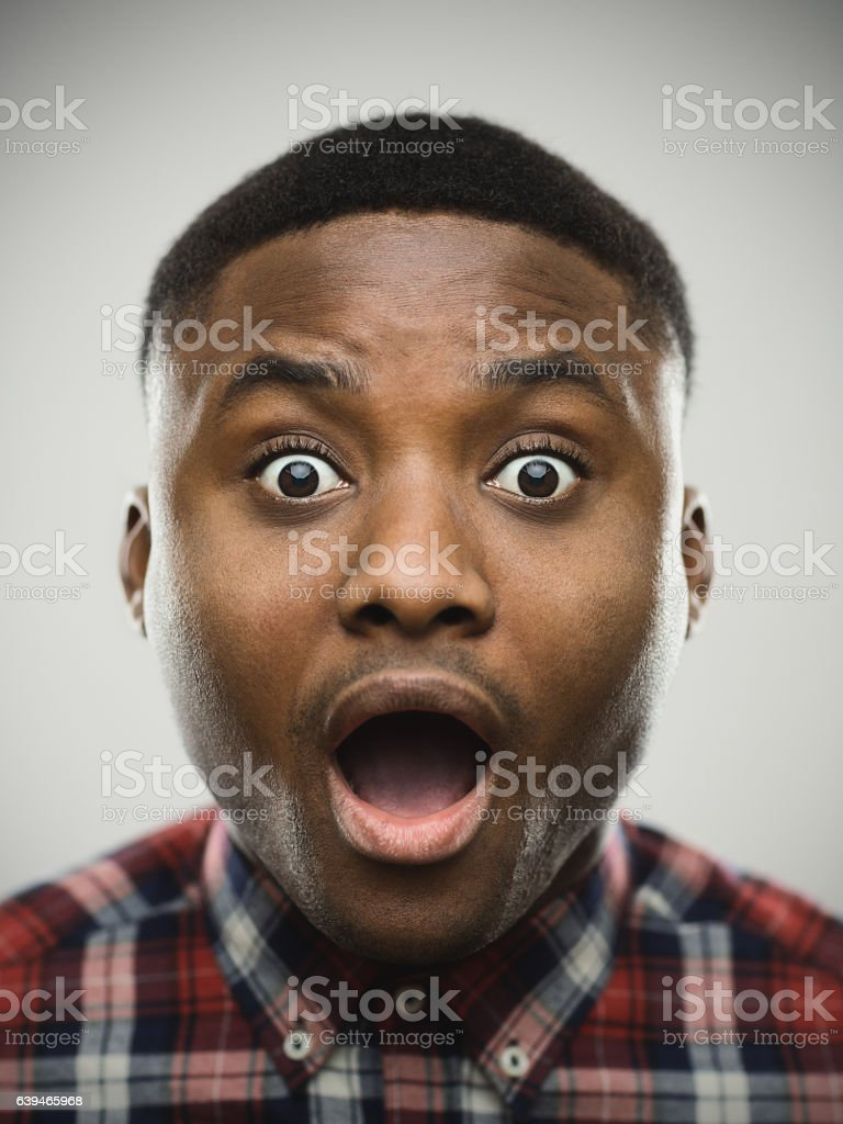 Close-up portrait of shocked man stock photo